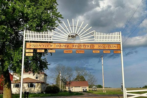 The landmark arch over the driveway to our dairy farm in Greenwood, WI