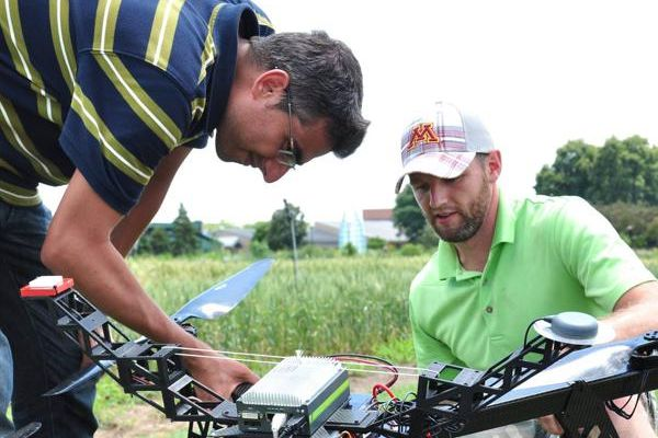 Flying the drone equipped with a hyperspectral camera over wheat plots